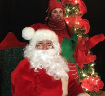 Le Père Noël et son elfe